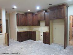 Installing Kitchen Cabinets. c.