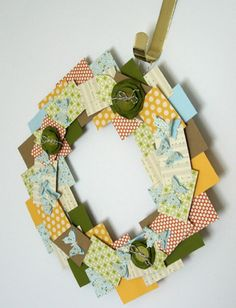 Scrapbook paper wreath - I'm thinking Evie's room on the closet door Paper Wreaths, Wooden Wreaths, Tissue Flowers, Paper Flowers, Scrapbook Cards, Scrapbooking, Square Wreath, Craft Projects, Craft Ideas