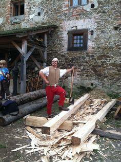 Reenactment at Castle Malesov, Kutna Hora, Czech Republic. September 2, 2012. Hewing Beams.