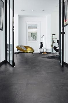 Painted Black laminate flooring in a contemporary living space. We love the black vase and the gold seat! Black Laminate Flooring, Dark Tile Floors, Grey Floor Tiles, Painting Tile Floors, Pvc Flooring, Black Floor, Grey Flooring, Painted Floors, Flooring Ideas