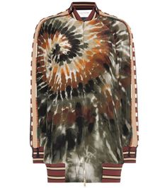 Valentino - Printed silk bomber jacket - The bomber silhouette is oh-so-coveted this season and Valentino shows it. Printed in a tie-dye-inspired motif in spirit of this season's retro craze, the ornate design is embellished with delicate beading to the sleeves. Ribbed trims keep the style sporty, and we like ours with strappy high-heeled sandals for an offbeat finish. seen @ www.mytheresa.com