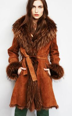 Sinequanone Fall Winter 2012-2013 - Goat skin long sleeve coat with Raccoon fur collar .... Cute, guess there's a surplus on Raccoons -