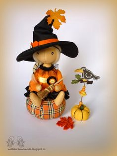 hand made by Mattek cute whimsical waldorf style halloween witch, pumpkin and crow ornament from felt