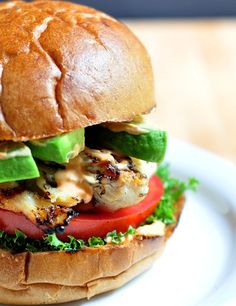 The Buttermilk Sriracha Chicken Burgers is an insanely delicious grilled chicken sandwich topped with avocado, bacon, and mayo with a slightly spicy punch!
