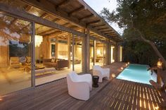 Kapama Karula is a romantic weekend getaway in Central Kruger Park. Set on the banks of the Klaserie River, which flows througho. Romantic Weekend Getaways, Private Games, Dream House Exterior, Game Reserve, House In The Woods, Lodges, Interior And Exterior, Safari, New Homes