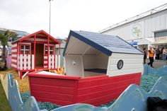 A Boat Playhouse! Red, white and blue paint gives this playhouse a nautical look. #nautical #Waltonsplayhouse #decorate