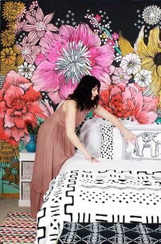 Two years ago I decided to paint a giant black and white flower mural on our bedroom wall. It was a really fun project and a SUPER cheap way to transform our bedroom (and our co-sleeping arrangement) Mural Floral, Flower Mural, Floral Wall Art, Bedroom Wall, Girls Bedroom, Bedroom Decor, Bedrooms, Design Bedroom, Floral Bedroom