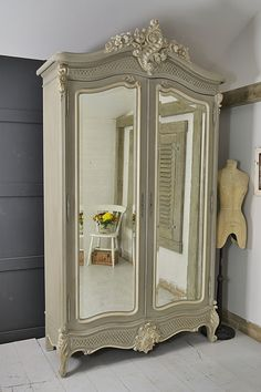 This beautiful shabby chic French Armoire would make a grand statement in any bedroom! We've painted in Annie Sloan French Linen with Old White detailing. Available with FREE UK Delivery! http://www.thetreasuretrove.co.uk/bedroom-storage/large-french-shabby-chic-knock-down-armoire