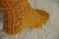 This cuff-down sock features a cute Owl motif and is worked from charts.