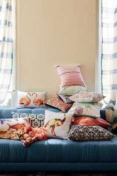 Add a pop of color to your home with statement pillows.