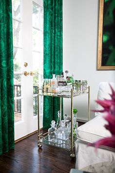 Sally Wheat Interiors, green malachite fabric drapes, vintage brass bar cart.