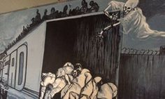 Murals at Altar's migrant shelter show the dangers faced by border crossers.
