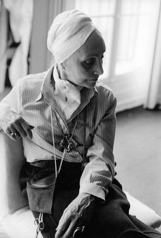"""Madame Grès, photographed by Eve Arnold, Paris, 1977 Germaine Émilie Krebs (1903–1993), known as Alix Barton and later as """"Madame Grès"""", relaunched her design house under the name Grès in Paris in 1942. Prior to this, she worked as """"Alix"""" or """"Alix Grès"""" during the 1930s.[1][2] Formally trained as a sculptress, she produced haute couture designs for an array of fashionable women, including the Duchess of Windsor, Marlene Dietrich, Greta Garbo, Jacqueline Kennedy, and Dolores del Río.[3]"""