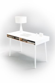 This streamlined desk is handmade from gorgeous solid white lacquered oak with stunning grains. Featuring two open compartments for easy access, superior craftsmanship and joinery means this is desk is extremely sturdy. Tapered legs come in your choice of natural or white oak. Looks great with our upholstered wood bench stool (see below). Made to order, it will take 2-3 weeks before it ships. Handmade in Spain.  – Desk arrives assembled; legs simply need to be screwed in.  – A matte acrylic…