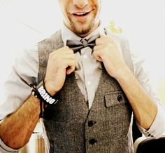 Tweed vest, white button down, and a bow tie. Keep it classy!