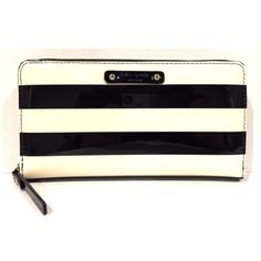 "Kate Spade black and cream striped Wallet Brand new! Kate Spade Wallet. Shiny patent with black and cream stripes and hot pink interior. Tag and care card inside, wallet was ordered online. FEATURES zip around continental wallet 12 credit card slots, 2 billfolds, zipper change pocket and exterior slide pocket  DETAILS 4""h x 7.6""w x 0.8""d kate spade Bags Wallets"