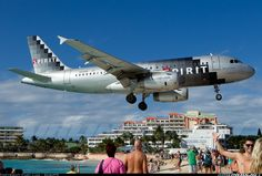 """""""Spirit Of Cancun"""", A Spirit Airlines A319, Flying over Maho Beach, about to land at St. Maarten. Cary Liao"""