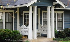 Double, fluted columns on small porch complete with built-in benches. front-porch-ideas-and-more.com #porch