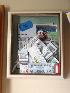 Ticket stub holder. Cheap shadow box frame, took staples off back panel and added song lyrics from our first concert and pics of us. Cut slit at the top of panel and glued it back on. Anniversary gift idea. DIY anniversary gift idea. anniversary gift for him Father's Day gift idea valentine's day gift for him