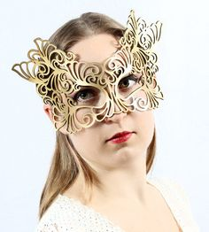 Rococo  leather mask in gold. $42.00, via Etsy.