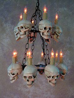 Six skulls in top level and eight skulls in bottom level. This chandelier would be great for any Halloween or Horror event. Skull Chandelier, Halloween Horror Prop. This chandelier would be great for any Halloween, horror, or Gothic event.