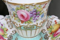 EB Foley: HAND PAINTED signed by A. Taylor, footed cup and saucer.