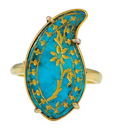 An Antique Persian Turquoise Boteh, later mounted as a Ring, The Turquoise engraved with a flowering plant within a decorated border, all inlaid with Gold. A six prong gallery and Gold ring mount safely hold the beautiful stone which dates from circa 1860.