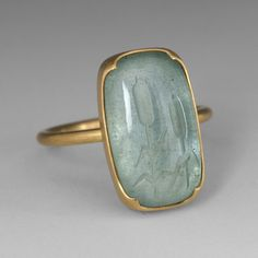Gabriella Kiss Ring: 18k gold and aquamarine carved with two cattails.