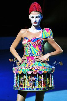 Manish Arora > expect Western silhouettes with the over the top colours, wholehearted kitsch, generous display of embroidery, appliqué and Indian craft techniques. Worn by Katy Perry, Heidi Klum and Lady Gaga among others.