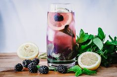 Boozy Blackberry Lemonade, a homemade spiked lemonade made with fresh summer berries and tart lemons. Perfect for hot summer afternoons! #lemonade #homemade #berries #cocktail