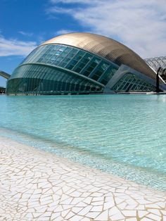 The Hemisfèric is one of many stunning buildings in the Valencia City of Arts and Sciences complex. The buildings are the work of Valencian architect Santiago Calatrava and have become iconic in the city. Architecture Antique, Futuristic Architecture, Beautiful Architecture, Art And Architecture, Unusual Buildings, Amazing Buildings, Santiago Calatrava, Magic Places, Places