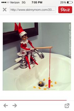 Elf on shelf fishing with cracker goldfish