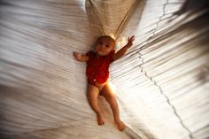 A girl rests in a hammock at her home at Shwe Pyi Tar Industrial Zone in Yangon on March 13, 2012. (Staff/Reuters) #