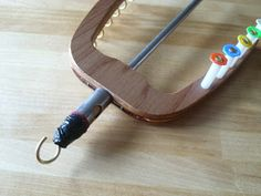 """Bockfilz: Bypassing the orifice - and recycling yarns ----- this is a very clever idea but could be executed better.... I'm thinking insert the hook in a cork that will fit tightly into the existing orifice so that you could simply """"plug"""" it into it."""
