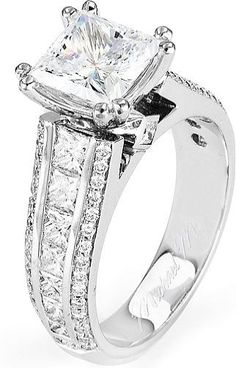 From Michael M. Collection Princess side bezels add hidden detail to this platinum Engagement Ring, featuring channel-set princess cut diamonds and rows of pave-set diamonds adding shine to the sides of the ring. Also available in white, yellow, and ro Princess Cut Rings, Princess Cut Engagement Rings, Platinum Engagement Rings, Engagement Ring Cuts, Princess Cut Diamonds, Princess Cut Wedding Sets, Solitaire Engagement, Ring Verlobung, Schmuck Design
