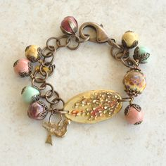 Wildflower Polymer Cuff Bracelet - the subtle movement of the dangling bronze bird & ceramic beads gives life to the picturesque floral cuff by gillianandlars on Etsy https://www.etsy.com/listing/200032779/wildflower-polymer-cuff-bracelet-the