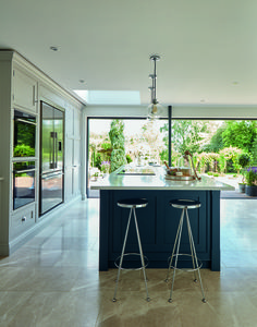 Statement painted kitchen island making the most of the beautiful garden views