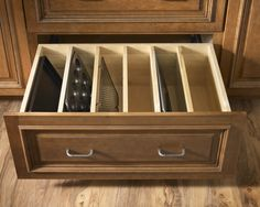 Deep drawer dividers for baking pans, etc. For more affordable options, OXO and Ikea make expandable drawer dividers to fit most standard drawers.