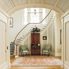 Walls - 9 Undeniably Southern Home Ideas - Southern Living - Use materials that are indigenous to the area. Cypress boards that are butted together line most of the interior walls, lending a subtle texture that gypsum drywall just can't provide. Traditional Staircase, Curved Staircase, Foyer Staircase, Entry Stairs, Staircase Makeover, Spiral Staircases, Staircase Design, Foyer Decorating, Southern Decorating