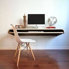 "Minimal Float Desk by Dario Antonioni.  60"" long x 18"" wide x 10"" high. In walnut or oak. Mounts to wall, built in drawer, pullout keyboard shelf. $899 retail, but on sale for $585 at Touch of Modern.com .... Nov 2012"
