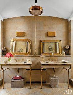 Honey-color stone lines the master bath of Stefano Pilati's Paris duplex.