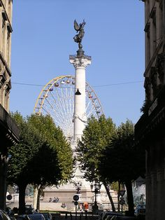 Bordeaux France They have a ferris wheel and a cool ass fountain.
