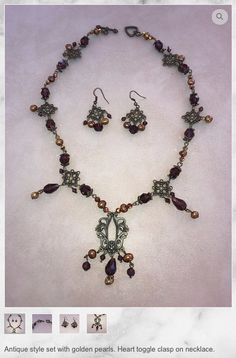 Antique style necklace and earring set with golden pearls
