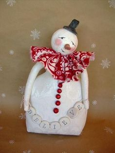 French Inspired Winter Farmhouse Cottage Primitive Snowman with BELIEVE Banner. $95.00, via Etsy.