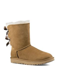 Two adorable bows update Ugg's signature Bailey boot of heavenly-soft sheepskin.   Genuine sheepskin and leather upper, sheepskin lining, synthetic sole   Imported   Fits true to size. If between size