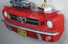Hunters hang moose heads and antlers on their walls. Car guys? We hang our favorite automobile bumpers on the wall. These 3-D Classic Car Shelves recreate the front-ends of your favorite rides and include a display shelf to show off your favorite car collectibles.