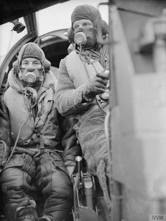 The pilot and the observer in the cabin of a Bristol Blenheim long range fighter of No. 245 (Northern Rhodesian) Squadron at RAF Aldergrove, Northern Ireland.