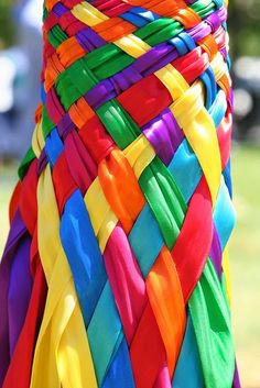 Brightly colored ribbons were woven around the pol...