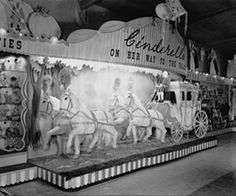Blackler's Liverpool, toy fair and grotto display of Cinderella's carriage at their Fleet Street warehouse, 1949. A close-up view of the carriage seen in the previous photograph of the toy fair, this is the centrepiece of Blackler's fairy tale scene. The large model complete with prancing horses and spectacular coach must have been an enchanting scene for any child but particularly for a post-war audience. Archive reference 491043-1