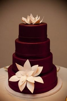Gorgeous simple brown cake with light pink lotus sugar flower accents